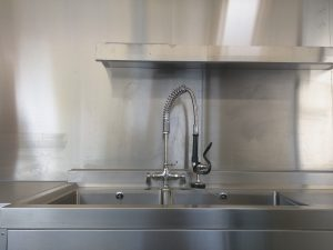 Stainless sink and drainer with overhead mixer tap