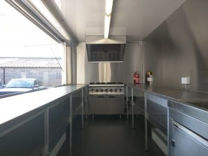 full stainless worksurfaces, cupboard and shelving